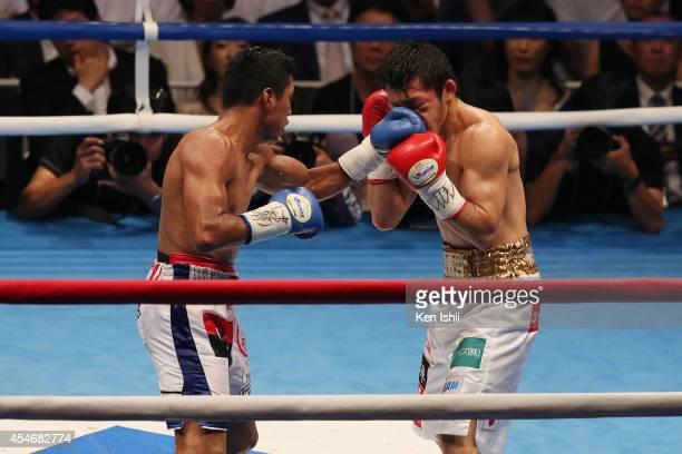 Akira Yaegashi of Japan receives a punch from Roman Gonzalez of Nicaragua during the WBC flyweight title bout between Akira Yaegashi of Japan and...