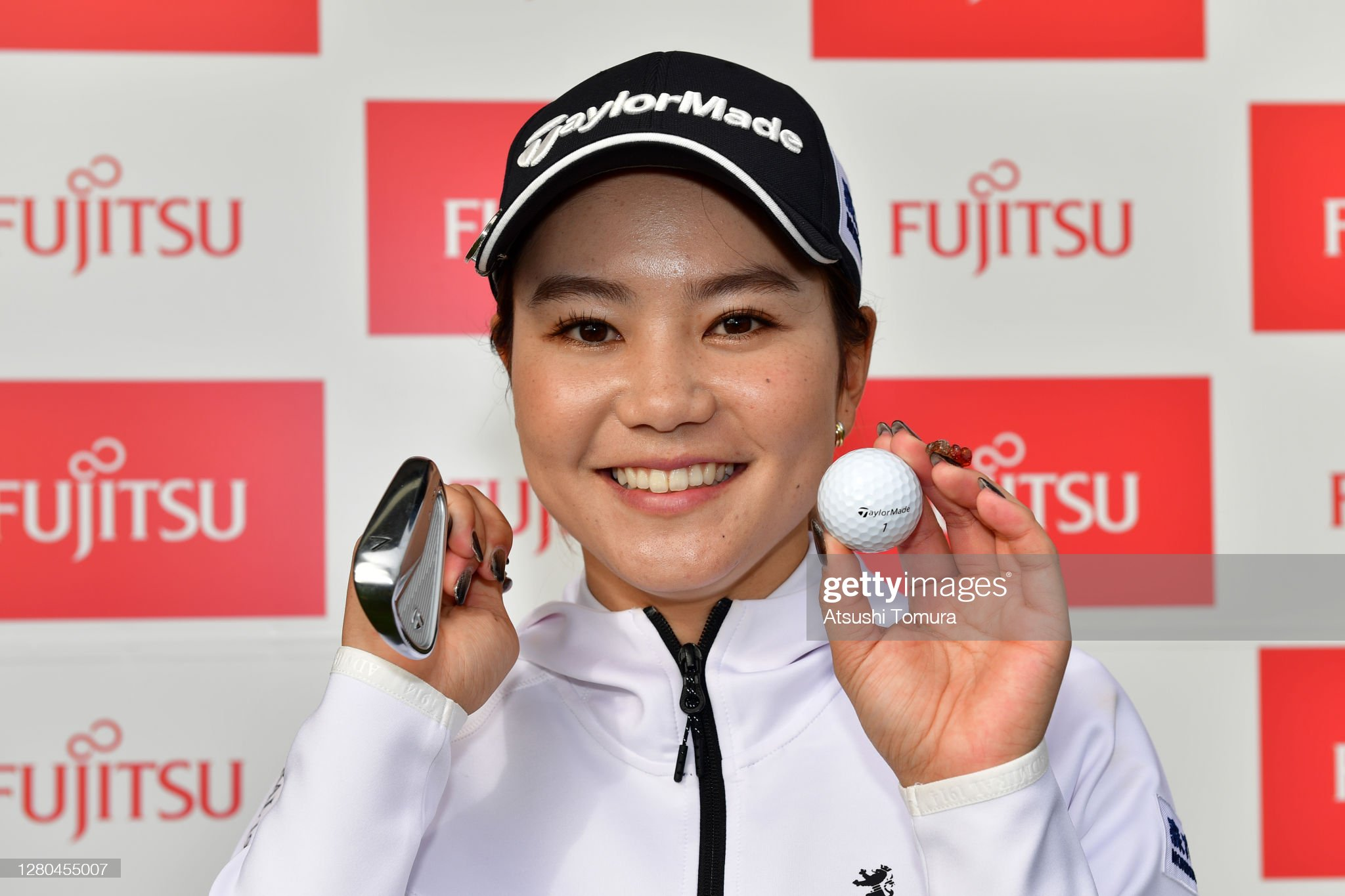 https://media.gettyimages.com/photos/akira-yamaji-of-japan-poses-as-she-made-a-holeinone-on-the-17th-hole-picture-id1280455007?s=2048x2048