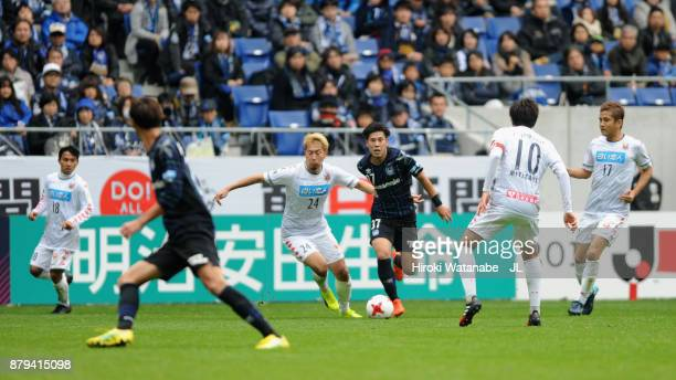 Akito Fukumori of Consadole Sapporo and Akito Takagi of Gamba Osaka compete for the ball during the JLeague J1 match between Gamba Osaka and...
