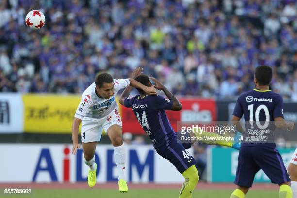 Akito Fukumori of Consadole Sapporo and Anderson Lopes of Sanfrecce Hiroshima compete for the ball during the JLeague J1 match between Sanfrecce...