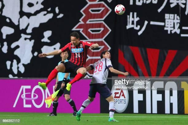 Akito Fukumori of Consadole Sapporo and Keigo Higashi of FC Tokyo compete for the ball during the JLeague J1 match between Consadole Sapporo and FC...