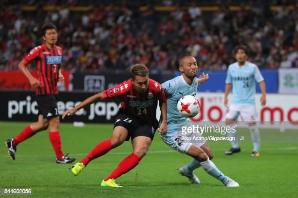 Akito Fukumori of Consadole Sapporo and Kengo Kawamata of Jubilo Iwata compete for the ball during the JLeague J1 match between Consadole Sapporo and...