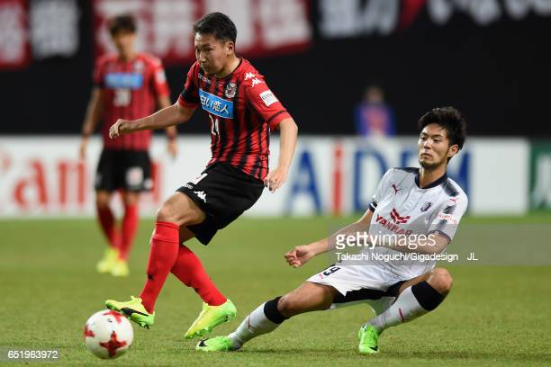 Akito Fukumori of Consadole Sapporo and Kenyu Sugimoto of Cerezo Osaka compete for the ball during the JLeague J1 match between Consadole Sapporo and...