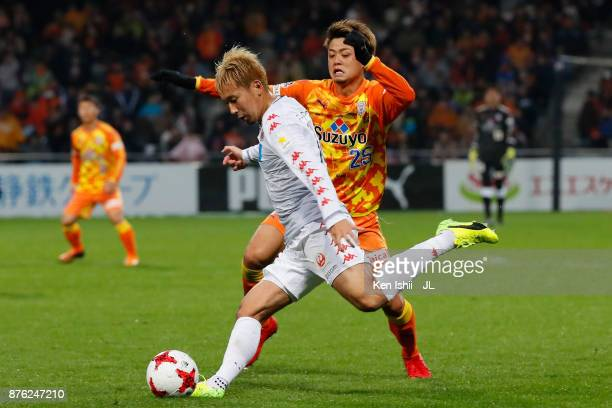 Akito Fukumori of Consadole Sapporo and Ko Matsubara of Shimizu SPulse compete for the ball during the JLeague J1 match between Shimizu SPulse and...