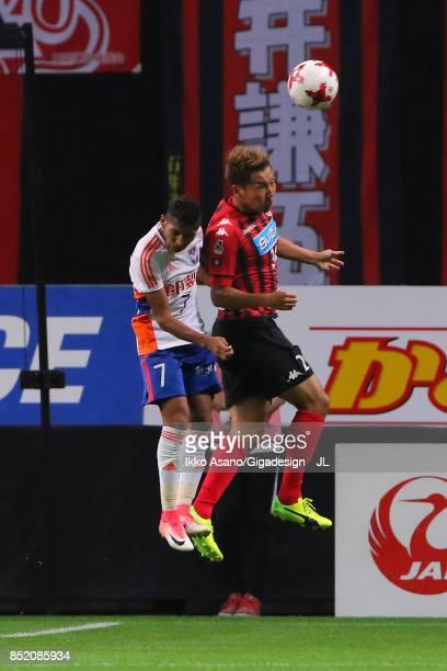 Akito Fukumori of Consadole Sapporo and Rony of Albirex Niigata compete for the ball during the JLeague J1 match between Consadole Sapporo and...