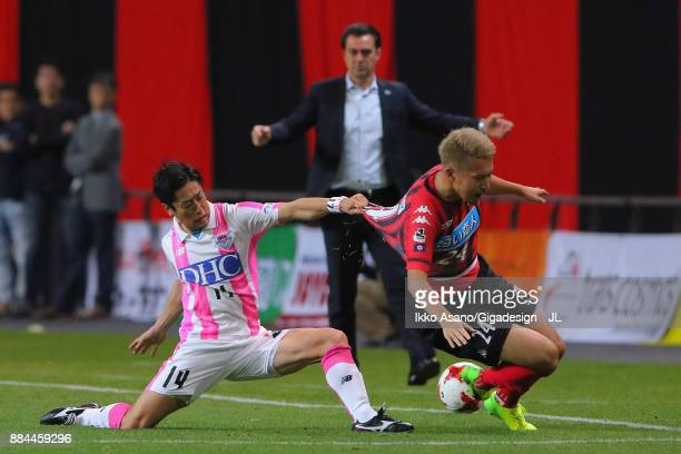 Akito Fukumori of Consadole Sapporo and Yoshiki Takahashi of Sagan Tosu compete for the ball during the JLeague J1 match between Consadole Sapporo...