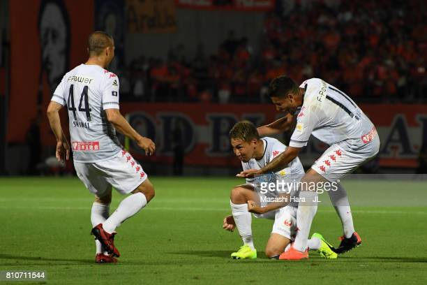 Akito Fukumori of Consadole Sapporo celebrates scoring his side's second goal with his team mates Shinji Ono and Reis during the JLeague J1 match...