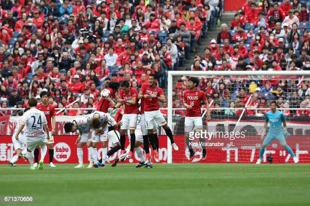 Akito Fukumori of Consadole Sapporo scores his side's second goal from a free kick during the JLeague J1 match between Urawa Red Diamonds and...