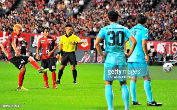 Akito Fukumori of Consadole Sapporo scores his side's third goal from a free kick during the JLeague J1 match between Consadole Sapporo and Vissel...