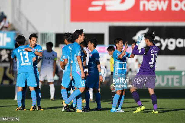 Akito Fukuta and Sagan Tosu players celebrate their 1-0 victory in the J.League J1 match between Sagan Tosu and Kashima Antlers at Best Amenity...
