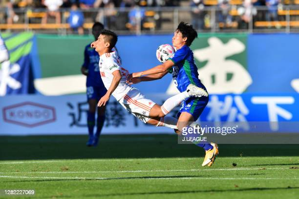 Akito FUKUTA of Albirex Niigata and Koki SUGIMORI of Tokushima Vortis battle for the ballduring the J.League Meiji Yasuda J2 match between Tokushima...