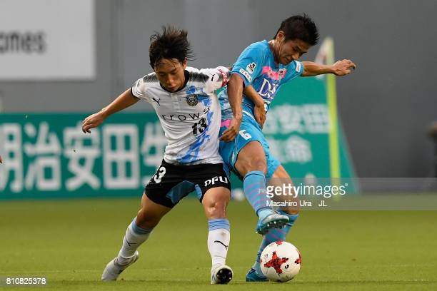 Akito Fukuta of Sagan Tosu and Koji Miyoshi of Kawasaki Frontale compete for the ball during the JLeague J1 match between Sagan Tosu and Kawasaki...