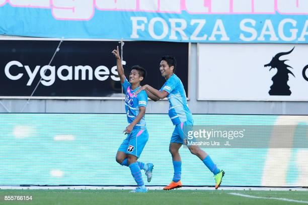 Akito Fukuta of Sagan Tosu celebrates scoring the opening goal with his team mate Riki Harakawa during the JLeague J1 match between Sagan Tosu and...