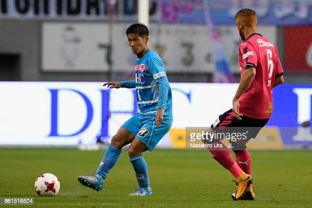 Akito Fukuta of Sagan Tosu takes on Souza of Cerezo Osaka during the JLeague J1 match between Sagan Tosu and Cerezo Osaka at Best Amenity Stadium on...