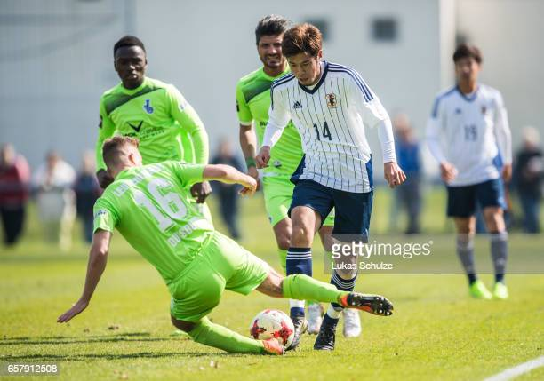 Akito Takagi is attacked by Fabio Leutenecker of Duisburg during a Friendly Match between MSV Duisburg and the U20 Japan on March 26 2017 in Duisburg...