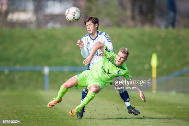 Akito Takagi of Japan and Fabio Leutenecker of Duisburg in action during a Friendly Match between MSV Duisburg and the U20 Japan on March 26 2017 in...