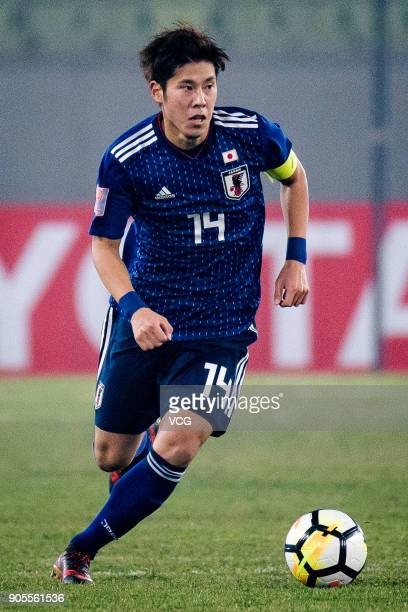 Akito Takagi of Japan drives the ball during the AFC U23 Championship Group B match between Japan and North Korea at Jiangyin Stadium on January 16...