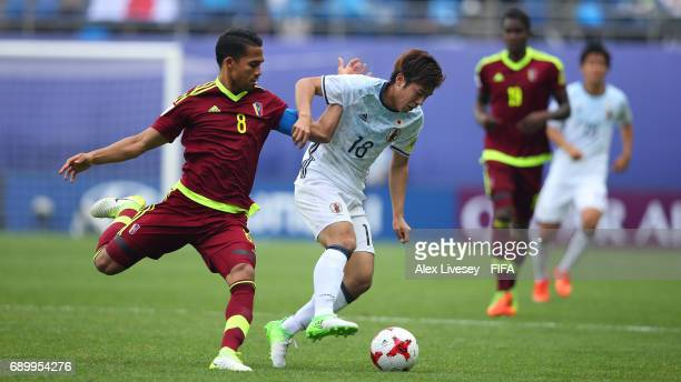 Akito Takagi of Japan holds off a challenge from Yangel Herrera of Venezuela during the FIFA U20 World Cup Korea Republic 2017 Round of 16 match...