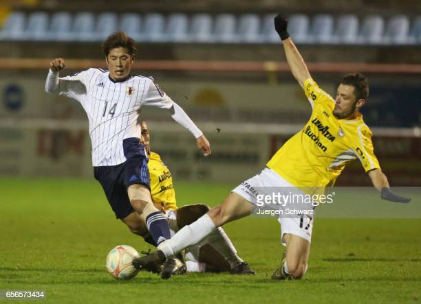 Akito Takagi of Japan tackles Julien Humbert of F91 during a friendly soccer match between F91 Diddeleng and the Japan U20 team at Stade Jos Nosbaum...