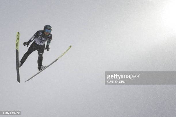 Akito Watabe from Japan soars in the air during the men's Gundersen Large hill jumping event at the FIS Nordic Combined World Cup on December 8, 2019...