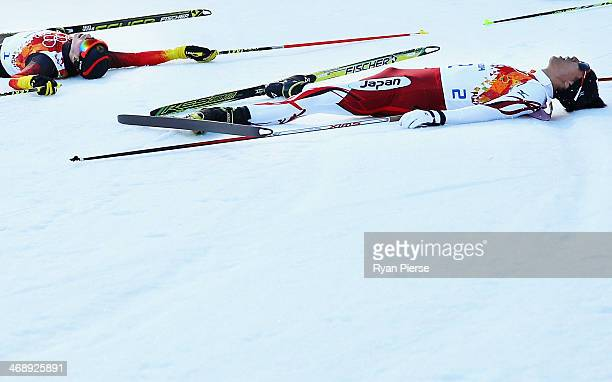 Akito Watabe of Japan and Eric Frenzel of Germany fall to the ground after the Nordic Combined Individual NH / 10 km during day five of the Sochi...