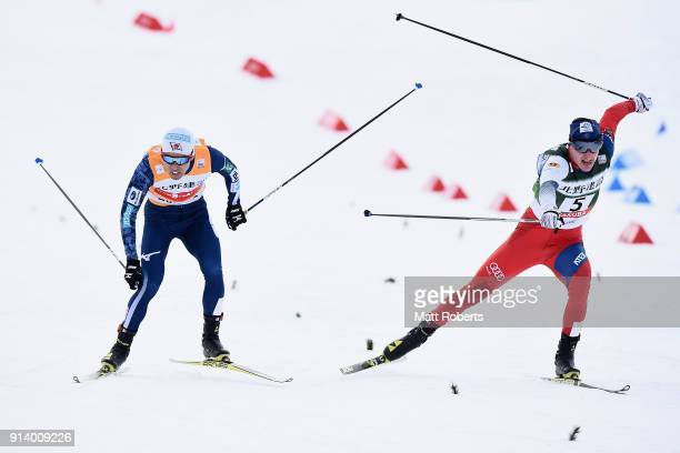 Akito Watabe of Japan and Tomas Portyk of Czech Republic compete in the Individual Gundersen LH/10km during day two of the FIS Nordic Combined World...