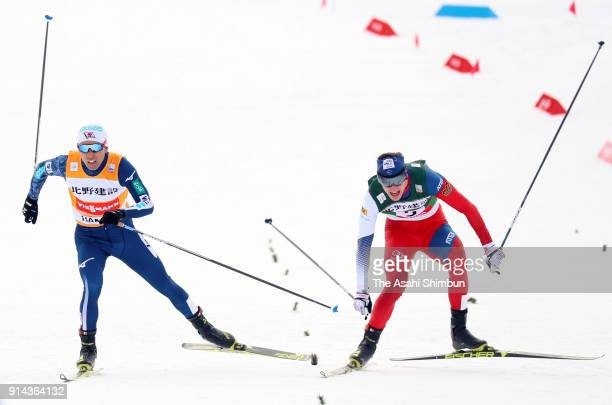 Akito Watabe of Japan and Tomas Portyk of the Czech Republic compete in the Individual Gundersen LH134/10km during day two of the FIS Nordic Combined...