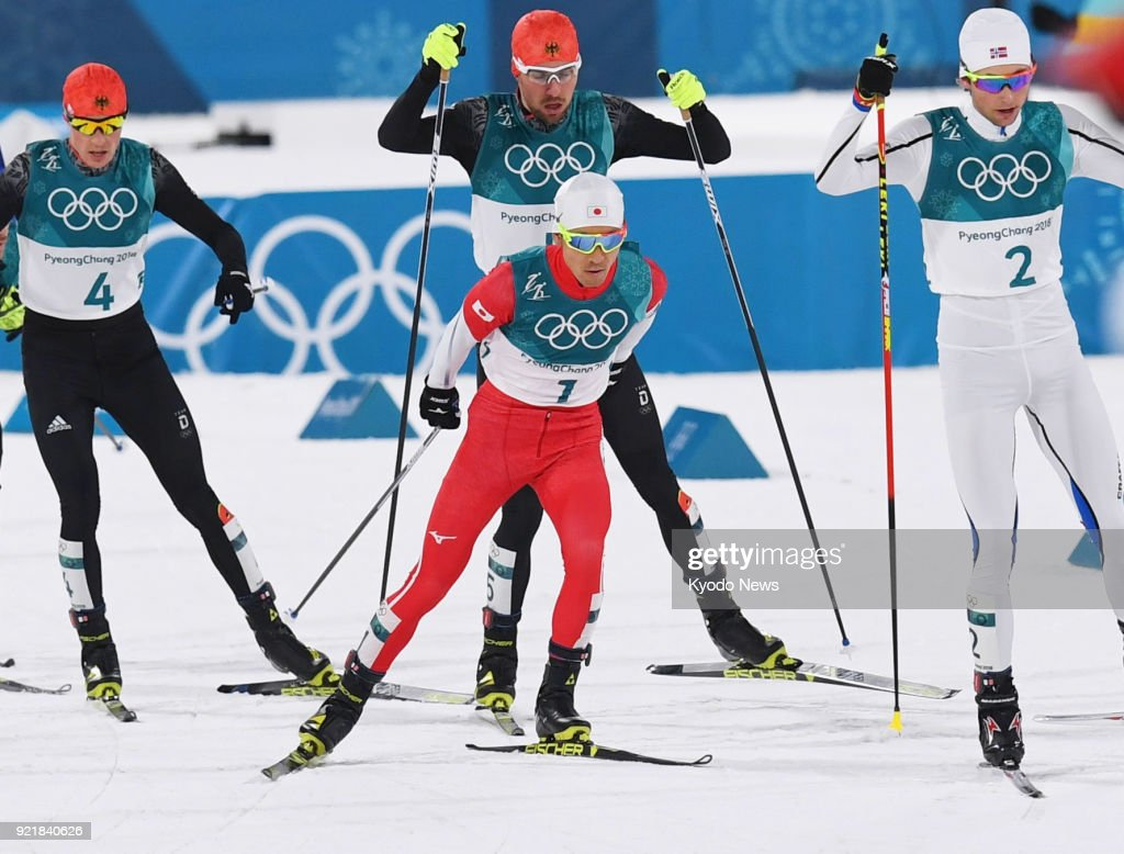 Akito Watabe (1) of Japan competes with Jarl Magnus Riiber (2) of Norway, Eric Frenzel (4) of Germany and Johannes Rydzek in the cross-country portion of the individual large hill 10-kilometer race at the Pyeongchang Winter Olympics in South Korea on Feb. 20, 2018. ==Kyodo