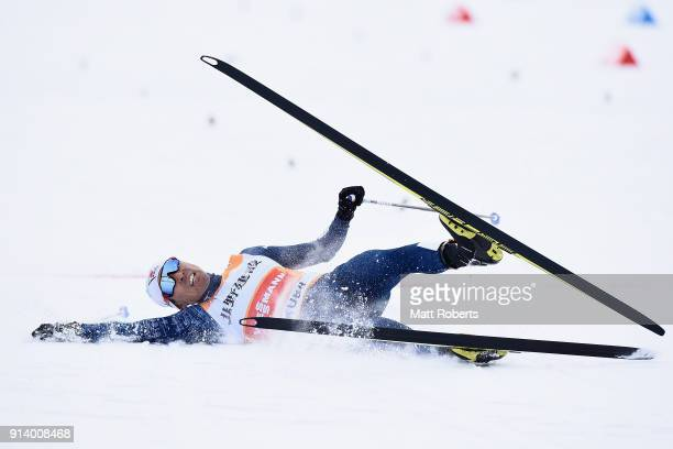 Akito Watabe of Japan crashes at the finish in the Individual Gundersen LH/10km during day two of the FIS Nordic Combined World Cup Hakuba on...