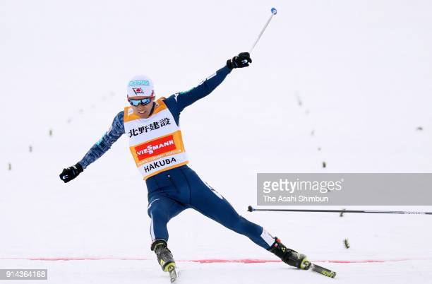 Akito Watabe of Japan crosses the finish line in the Individual Gundersen LH134/10km during day two of the FIS Nordic Combined World Cup Hakuba on...