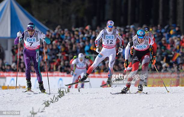 Akito Watabe of Japan Jan Schmid of Norway and Lukas Klapfer of Austria fight for first place during Day Two of the FIS Nordic Combined World Cup HS...