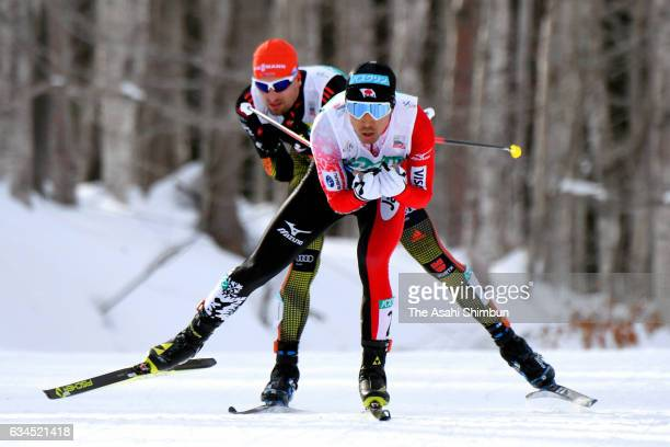 Akito Watabe of Japan leads to Bjoern Kircheisen of Germany in the crosscoutry during day one of the FIS Nordic Combined Sapporo at Shirahatayama...