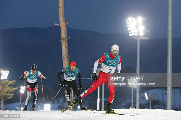 Akito Watabe of Japan wins the silver medal Eric Frenzel of Germany wins the gold medal Lukas Klapfer of Austria wins the bronze medal during the...