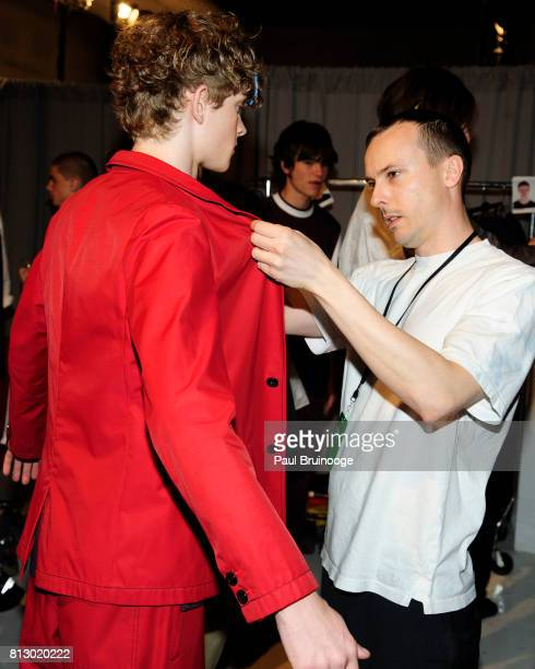 Akiva Miller and Patrik Ervill prepare backstage at the Patrik Ervell show during NYFW Men's July 2017 at Skylight Clarkson Sq on July 11 2017 in New...