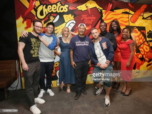 Akiva Schaffer Andy Samberg Busy Phillips Roy Choi Tim Robinson Sam Richardson Brandi Ray and Terika Palmer attend The Flamin Hot Spot Cheetos new...