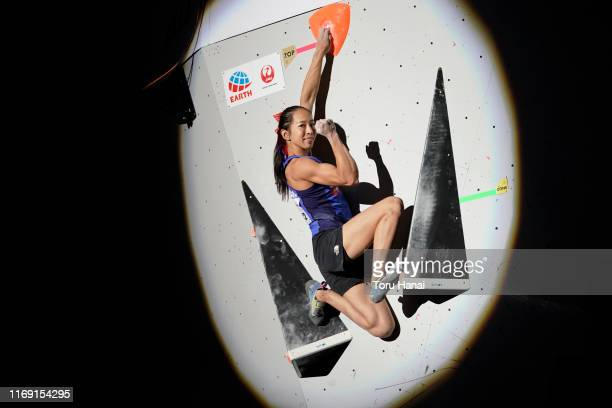 Akiyo Noguchi of Japan celebrates as she competes in the Bouldering during Combined Women's Final on day ten of the IFSC Climbing World Championships...