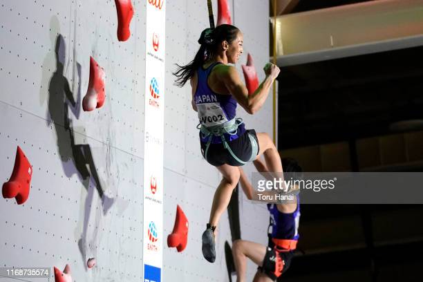 Akiyo Noguchi of Japan celebrates while competing in the Speed event during the Combined Women's Qualification on day eight of the IFSC Climbing...