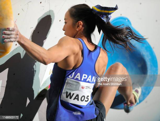 Akiyo Noguchi of Japan competes in the Women's Bouldering final during day three of the IFSC Climbing World Championships at Esforta Arena Hachioji...