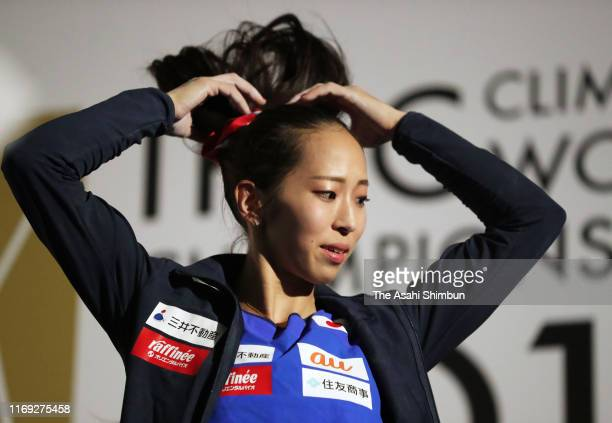 Akiyo Noguchi of Japan shows her emotion after competing in the Lead of the Women's Combined final on day ten of the IFSC Climbing World...