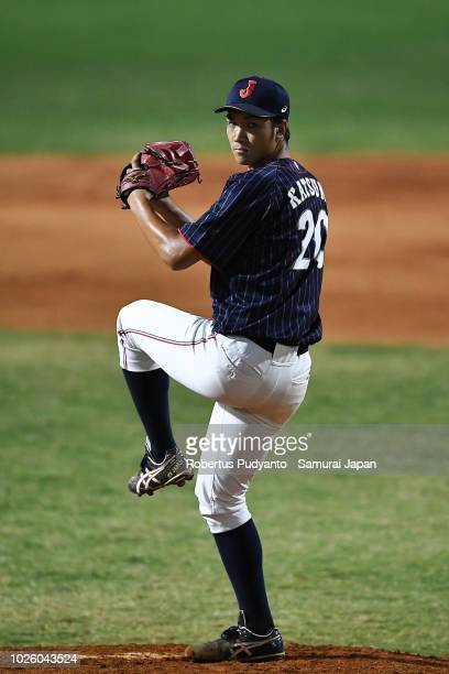 Akiyoshi Katsuno of Japan pitches during the ninth inning of the Men's Baseball Team Final match between Japan and Korea on day fourteen of the Asian...