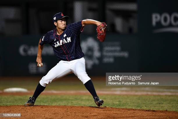 Akiyoshi Katsuno of Japan pitches during the seventh inning of the Men's Baseball Team Final match between Japan and Korea on day fourteen of the...