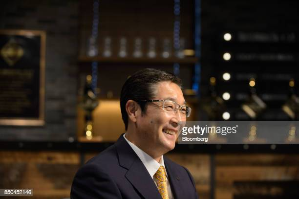 Akiyoshi Koji president and chief operating officer of Asahi Group Holdings Ltd reacts during an interview in Tokyo Japan on Thursday Sept 21 2017...