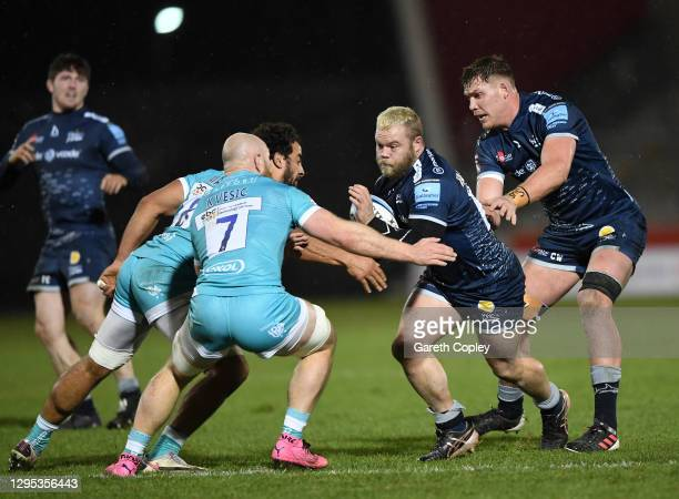 Akker van der Merwe of Sale is tackled by Matt Kvesic of Worcester during the Gallagher Premiership Rugby match between Sale Sharks and Worcester...