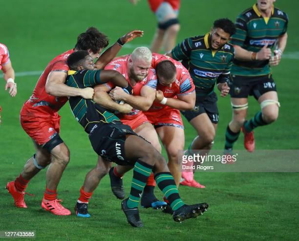 Akker van der Merwe of Sale Sharks charges upfield despite being held by Manny Iyogun during the Gallagher Premiership Rugby match between...