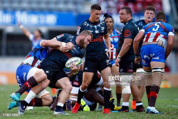 Akker van der Merwe of the Cell C Sharks is tackled during the Super Rugby match between Cell C Sharks and Vodacom Bulls at Jonsson Kings Park on...