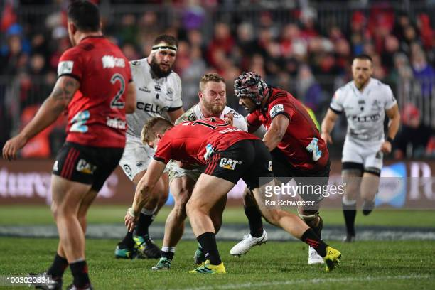 Akker van der Merwe of the Sharks is tackled by Jack Goodhue of the Crusaders and Jordan Taufua of the Crusaders during the Super Rugby Qualifying...