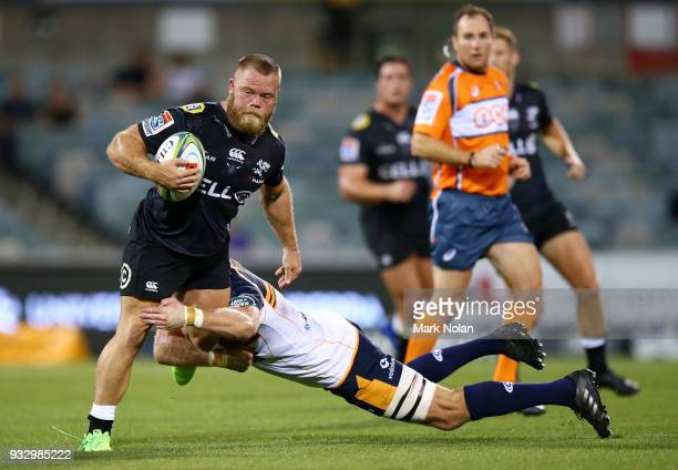 Akker van der Merwe of the Sharks is tackled during the round five Super Rugby match between the Brumbies and the Sharks at GIO Stadium on March 17...