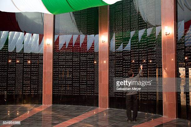 Ako Abdullah takes a camera phone photograph of the names of those who died during the 1988 gas attack at the Halabja Memorial Museum. Although Iraqi...