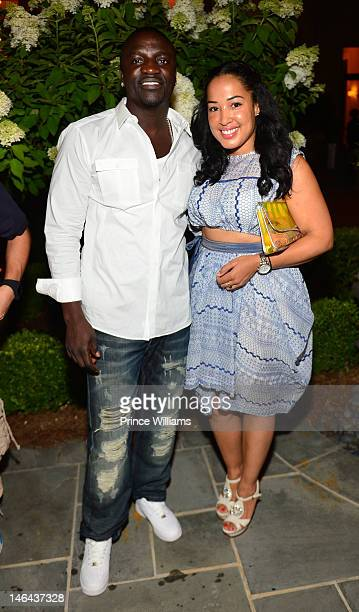 Akon and Jennifer Drake attend Jason Geter And Bu Thiam Present Dinner A Toast on June 16 2012 in Atlanta Georgia