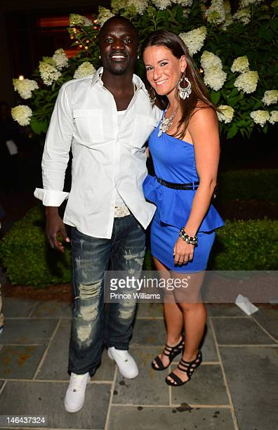 Akon and Julia Beverly attend Jason Geter And Bu Thiam Present Dinner A Toast on June 16 2012 in Atlanta Georgia